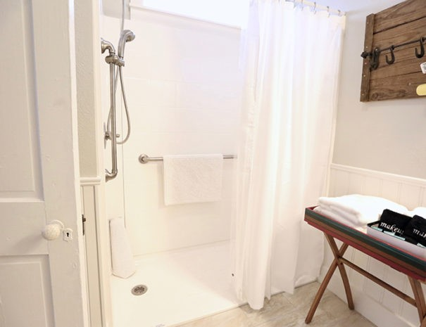 bathroom of the Bob Bunker Room with roll-in shower for ADA accessibility