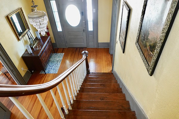 looking at Bryn Oaks entry way from halfway up staircase