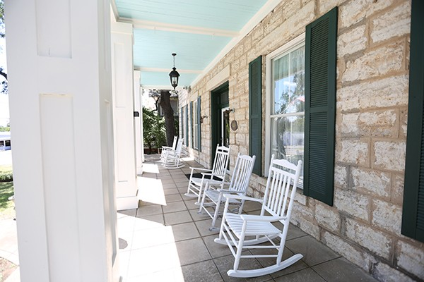 front porch of Bryn Oaks with white rocking chairs along porch