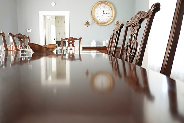 closeup of dining table looking in towards kitchen