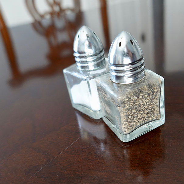 closeup of salt and pepper shakers on dining table
