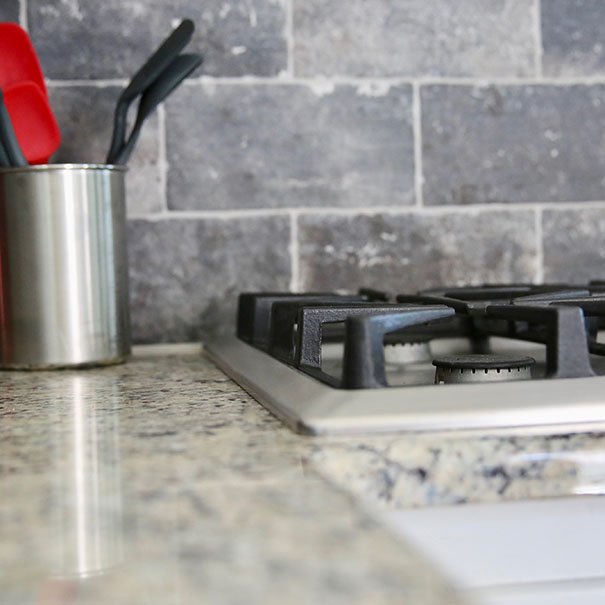 closeup of gas stove top in kitchen