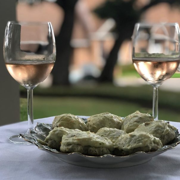 plate of Earl Gray cookies with two glasses of rose wine